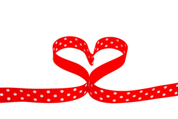 heart shaped polka dot red ribbon on white background
