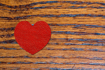 red heart on wooden plank