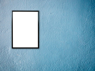 poster frame on blue paint wall background