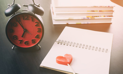 Heart Valentines diary with red clock morning concept.