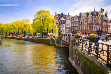 Traditional old buildings and and boats in Amsterdam, Netherland