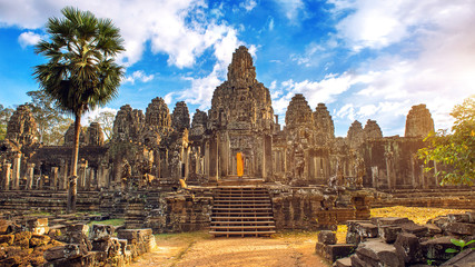 Ancient stone faces at sunset of Bayon temple, Angkor Wat, Siem reap, Cambodia.