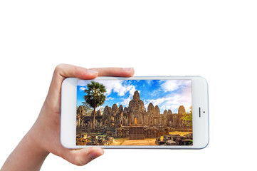 Hand holding Smartphone with image of Angkor Wat Temple, Siem reap in Cambodia.