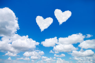couple white heart shaped clouds on blue sky