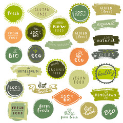 Organic food labels set. Fresh healthy food icons. Vintage badges for restaurant menu or food package. Eco friendly raw vegan products logo templates. Hand lettering, calligraphy, brush smears