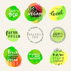 Watercolor organic labels collection. Retro style set of 100% bio organic gluten free eco bio food restaurant menu logo label templates with floral and vintage elements and watercolour splashes