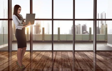 Young asian business woman working using laptop