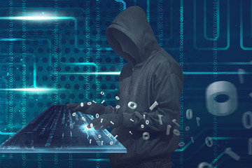 Hooded man with anonymous mask typing on virtual keyboard
