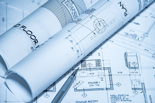 architecture blueprints and house plans on the table and technical pencil. architectural design on paper, construction technical plan, renovation project