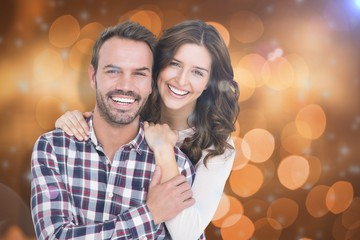 Composite image of portrait of young couple smiling