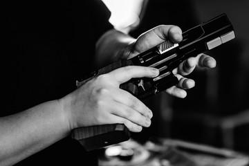 Woman pulling pistol on sport shooting training