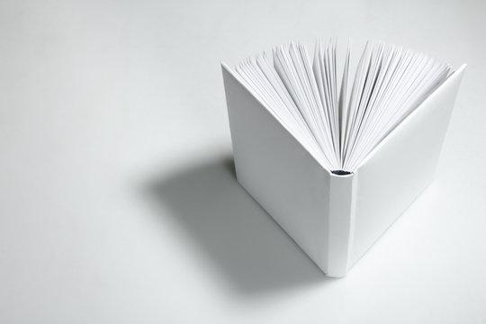Open empty white book. Top view.