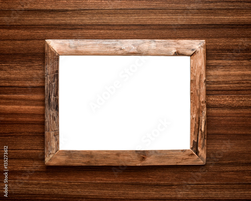 Rustic handmade wooden picture frame on wood background. White space ...