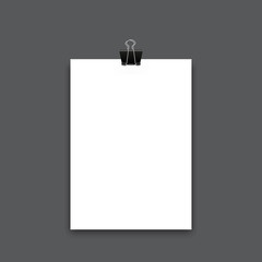 Realistic sheet of paper with clip. Photo realistic vector paper with paper clip and shadow