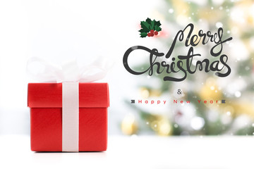 Gift box with Merry Christmas and Happy New Year text
