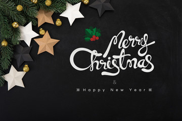 Merry Christmas and Happy New Year text with ornaments on blackboard background