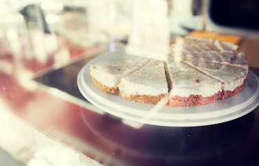 close up of cake on stand in cafe showcase