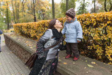 Mother and son in the park in autumn