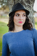 Stylish young woman with black hat
