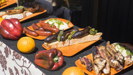 Barbecue scene with peppers and pork at a medieval fair in spain