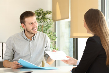 Man giving resume in a job interview