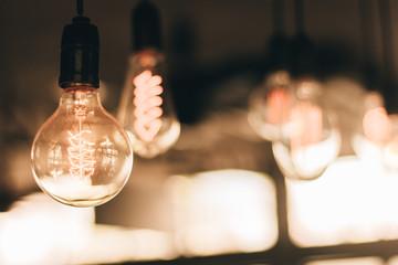 Glow old vintage ligth bulb with vintage filter (selective focus)
