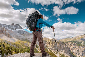 hiker with backpack standing on top of mountain