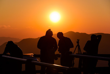 Silhouette of photographer, taking pictures of the beautiful mom