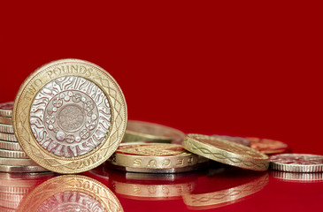 British Coins over Bright Red Background