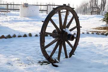 The old cart lost in snows of the serbian farm
