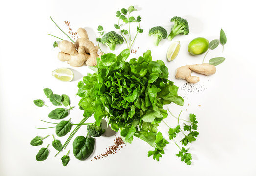 Green salad ingredients on white background. Healthy food concept