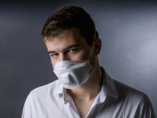 Portrait of a young man with a protective face mask