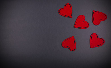 red hearts on the black board background texture