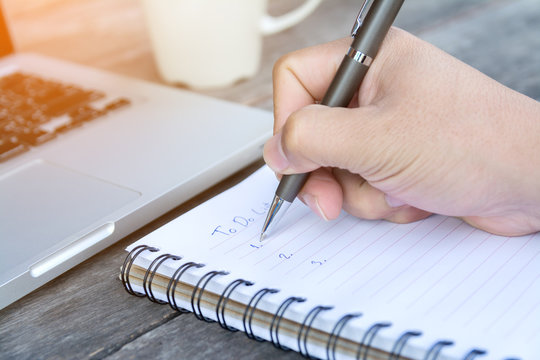 hand write to do list on notebook