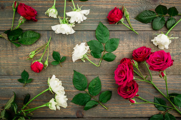 Floral pattern made white and red roses on wood background. Flat lay, top view. Valentine's background