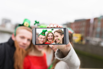 Group of Friends Taking a Picture with a Mobile Phone . St Patri