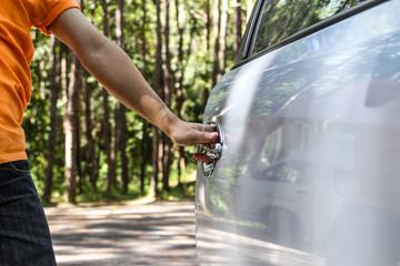 man opening his car door