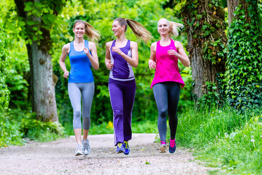 Women in forest running for sport