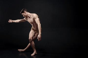 Flexile ballet dancer performing in the studio