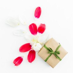 Tulip petals and gift box on white background. Flat lay, top view. Valentines Day background.