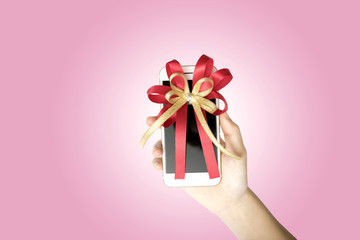 modern touch-screen mobile phone with ribbon on white background