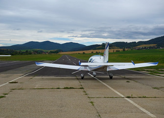 small sport aircraft ready for the start of in the aerodrome