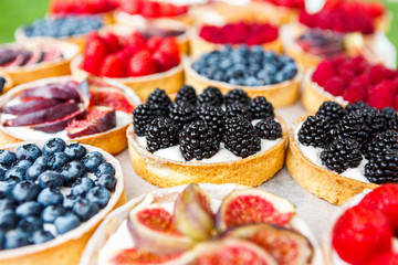 Wall Murals Dessert Closeup of blackberry tart dessert tray assorted