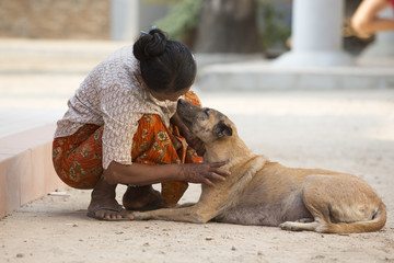 street dog with generous woman