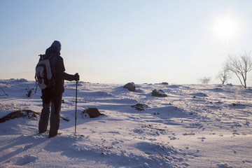 Photo sur Toile Gris Hiker silhouette hiking in winter season
