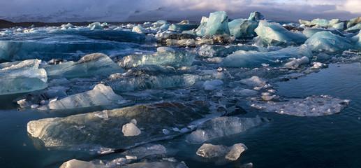 Panoramic view of blue icebergs floating in the Jokulsarlon lake