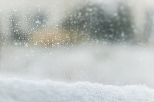 Snow covered car window glass view from inside