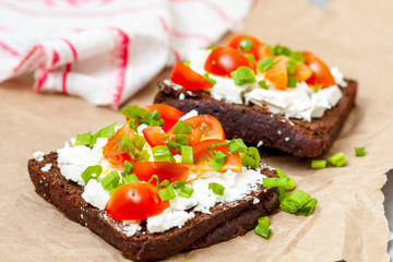 Sandwiches with healthy rye bread, feta and green onions. Love for a healthy food concept