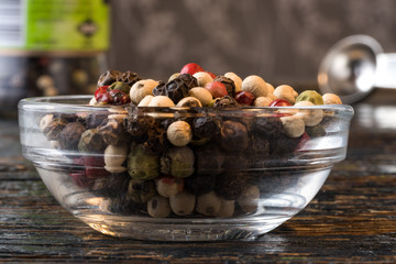 Multi-colored peppercorns in an ingredient bowl