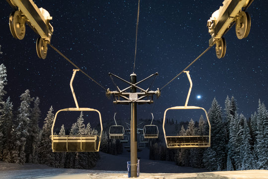 Ski lift under a cold and star filled night sky in the Elkhorn Mountains of Oregon